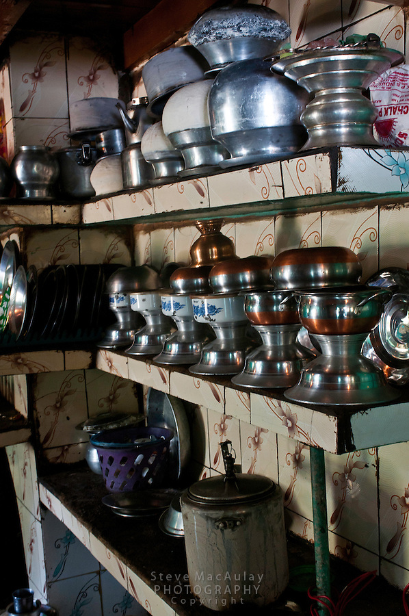 Interior view of shiny stainless cookware in kitchen of Bakarwal tribal family, Wangath, Kashmir, India.