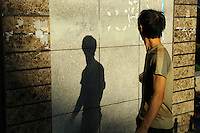 A man looking at his shadow.