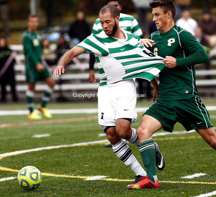 Waterbury, CT- 23 October 2013-102313CM09-    Post University's Jean Louis Cadet goes for the ball as LIU Post's Per Forgaard grabs on his shirt during their soccer match in Waterbury Wednesday afternoon. Post won, 1-0, handing LIU their first loss of the season.   Christopher Massa Republican-American