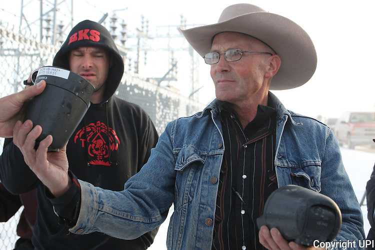 Activists LaVoy Finicum holds two FBI surveillance cameras found at a power station near the Malheur National Wildlife Reserve on January 15, 2016 in Burns, Oregon.  Ammon Bundy and about 20 other protesters took over the refuge on Jan. 2 after a rally to support the imprisoned local ranchers Dwight Hammond Jr., and his son, Steven Hammond. Another surveillance camera was found near the reserve.    Photo by Jim Bryant/UPI