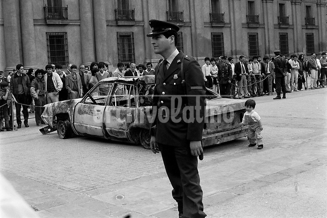 En la Plaza de la Constitucivon frente al palacio de gobierno fueron exhibidos los autos de los escoltas de Augusto Pinochet tras el atentado en que intentaron ajusticiarlo miembros del Frente Patriotico Manuel Rodriguez. Santiago Chile 9 Septiembre 1986<br /> Forty years ago, on September 11, 1973, a military coup led by General Augusto Pinochet toppled the democratic socialist government of Chile. President Salvador Allende was killed during the  attack to seize  La Moneda presidential palace.  In the aftermath of the coup, a quarter of a million people were detained for their political beliefs, 3000 were killed or disappeared and many thousands were tortured.<br /> Some years later in 1981, while Pinochet ruled Chile with iron fist, a young photographer called Juan Carlos Caceres started to freelance in the streets of Santiago and the poblaciones or poor outskirts, showing the growing resistance against the dictatorship. For the next 10 years Caceres photographed every single protest and social movement fighting for the restoration of democracy. He knew that his camera was his only weapon, he knew that his fate was to register the daily violence and leave his images for the History.<br /> In this days Caceres is working to rescue and organize his collection of images in the project Imagenes de la Resistencia   . With support of some Chilean official institutions, thousands of negatives are digitalized and organized to set up the more complete visual heritage of this  violent period of Chile&acute;s history.<br /> In a time when technology was not very friendly and communications were kind of basic, Juan Carlos Caceres and other photojournalist were always at the right place in the right moment defying the threats of the police. Their work is now  a visual heritage that documents and remind us the fight of Chilean people for democracy.
