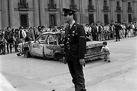 En la Plaza de la Constitucivon frente al palacio de gobierno fueron exhibidos los autos de los escoltas de Augusto Pinochet tras el atentado en que intentaron ajusticiarlo miembros del Frente Patriotico Manuel Rodriguez. Santiago Chile 9 Septiembre 1986<br /> Forty years ago, on September 11, 1973, a military coup led by General Augusto Pinochet toppled the democratic socialist government of Chile. President Salvador Allende was killed during the  attack to seize  La Moneda presidential palace.  In the aftermath of the coup, a quarter of a million people were detained for their political beliefs, 3000 were killed or disappeared and many thousands were tortured.<br /> Some years later in 1981, while Pinochet ruled Chile with iron fist, a young photographer called Juan Carlos Caceres started to freelance in the streets of Santiago and the poblaciones or poor outskirts, showing the growing resistance against the dictatorship. For the next 10 years Caceres photographed every single protest and social movement fighting for the restoration of democracy. He knew that his camera was his only weapon, he knew that his fate was to register the daily violence and leave his images for the History.<br /> In this days Caceres is working to rescue and organize his collection of images in the project Imagenes de la Resistencia   . With support of some Chilean official institutions, thousands of negatives are digitalized and organized to set up the more complete visual heritage of this  violent period of Chile´s history.<br /> In a time when technology was not very friendly and communications were kind of basic, Juan Carlos Caceres and other photojournalist were always at the right place in the right moment defying the threats of the police. Their work is now  a visual heritage that documents and remind us the fight of Chilean people for democracy.