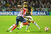 BARRANQUIILLA - COLOMBIA, 05-12-2018:Luis Diaz  (Izq.) de Junior disputa el balón con Junior (Der.) del Paranaense durante el encuentro entre Atlético Junior de Colombia e Atlético Paranaense de Brasil por la final, ida, de la Copa CONMEBOL Sudamericana 2018 jugado en el estadio Metropolitano Roberto Meléndez de la ciudad de Barranquilla. / Luis Diaz (L) of Junior struggles for the ball with Junior (R) of Paranaense during a final first leg match between Atletico Junior of Colombia and Atlético Paranaense of Brazil as a part of Copa CONMEBOL Sudamericana 2018 played at Roberto Melendez Metropolitan stadium in Barranquilla city Atlético Junior de Colombia y Atlético Paranaense de Brasil en partido por la final, ida, de la Copa CONMEBOL Sudamericana 2018 jugado en el estadio Metropolitano Roberto Meléndez de la ciudad de Barranquilla. / Atletico Junior of Colombia and Atletico Paranaense of Brazil in Final first leg match as a part of Copa CONMEBOL Sudamericana 2018 played at Roberto Melendez Metropolitan stadium in Barranquilla city.  Photo: VizzorImage / Alfonso Cervantes / Cont