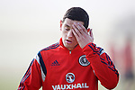 Graham Dorrans after putting in some effort at a foggy Scotland training