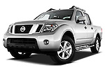 Low aggressive front three quarter view of 2010 Nissan Navara LE 4 door Pick-Up Truck.