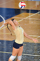 12 October 2008:  FIU setter Natalia Valentin (9) serves in the FIU victory 3-0 (25-18, 25-17, 25-20) over North Texas at Panther Arena in Miami, Florida.