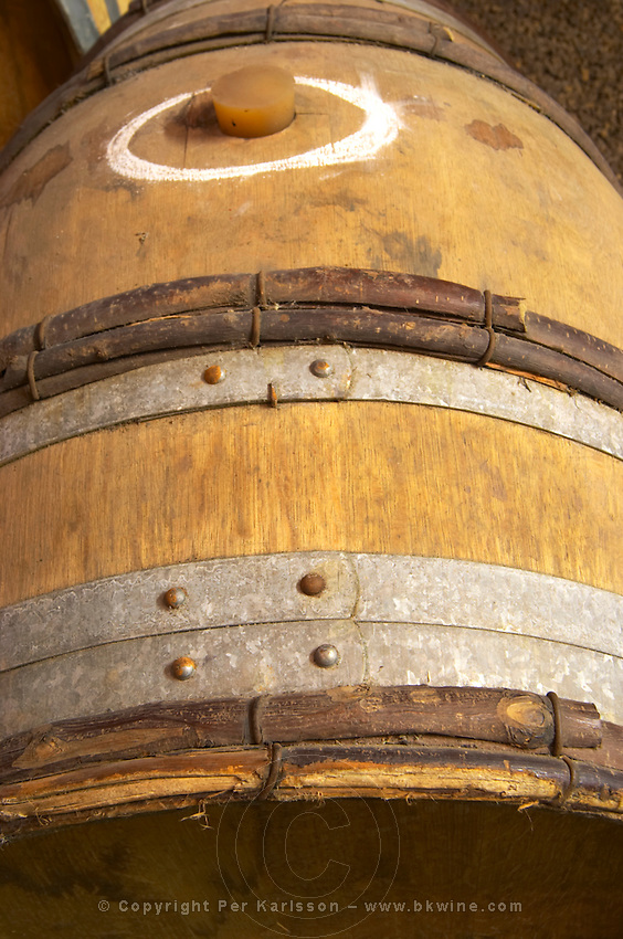Domaine Mas Champart, barrel marked with O, circle, signifying that it is filled with Eaux (O) de Vie distilled grape spirit. St Chinian. Languedoc. Barrel cellar. France. Europe.