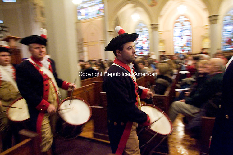 WATERBURY, CT- 06 JAN 2008- 010608JT05-<br /> Scott Thibodeaux of the Mattatuck Drum Band of Waterbury plays with his fellow drummers at the Shrine of Saint Anne in Waterbury during the church's third annual Boar's Head Festival on Sunday. <br /> Josalee Thrift / Republican-American