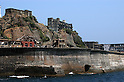 Hashima (Gunkanjima), Nagasaki, Japan. The island was the location of a mine which was shuttered in the mid 20th century. When the population of 4,000 left, the island turned into a ghost town.