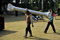 Workers carry a pillar prop at Grewal Farms, one of many wedding reception centres in Amritsar which employs hundreds of staff during the wedding season to work around the clock hosting day and night marriage ceremonies and parties.