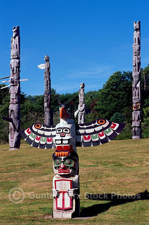 Kwakwaka'wakw (Kwakiutl) Memorial Totem Poles, on Namgis Burial Grounds, Alert Bay, Cormorant Island, BC, British Columbia, Canada