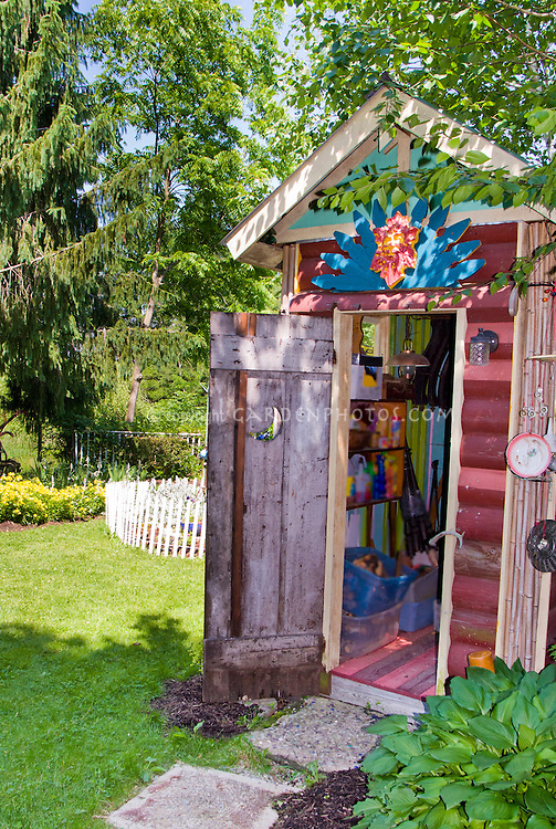 Fun garden shed plant flower stock photography for Interesting garden buildings