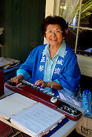 Asian woman playing instrument
