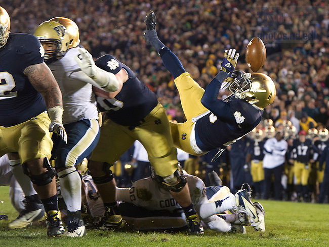 Nov. 3, 2012; Running back Cierre Wood fumbles the ball while diving into the end zone during overtime against Pittsburgh. Photo by Barbara Johnston/University of Notre Dame