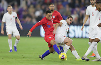 ORLANDO, FL - NOVEMBER 15: Jonathan Osorio #21 of Canada and  Sergino Dest #18 of the United States battle for a ball during a game between Canada and USMNT at Exploria Stadium on November 15, 2019 in Orlando, Florida.