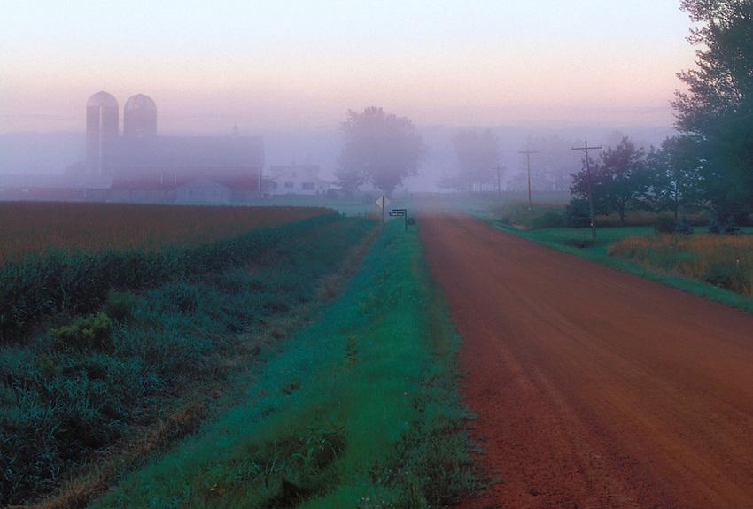 Early morning fog blankets a farm near Abbotsford, Wis.
