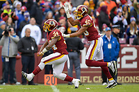 Landover, MD - December 9, 2018: Washington Redskins Byron Marshall (34) and Washington Redskins linebacker Josh Harvey-Clemons (40) celebrate after a big hit on special teams during game between the New York Giants and Washington Redskins at FedEx Field in Landover, MD. The Giants defeated the Redskins 40-16 dropping the Redskins to 6-7 on the season. (Photo by Phillip Peters/Media Images International)