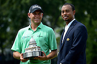 June 30, 2013  (Bethesda, Maryland)  AT&T National Champion Bill Haas hold the championship trophy with Tiger Woods. Haas won the tournament at 12-under, three strokes better than Roberto Castro, who finished second.  (Photo by Don Baxter/Media Images International)