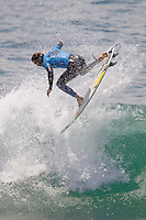 South African Jordy Smith completes an air but is defeated by American Brett Simpson during the 2010 US Open of Surfing in Huntington Beach, California on August 6, 2010.