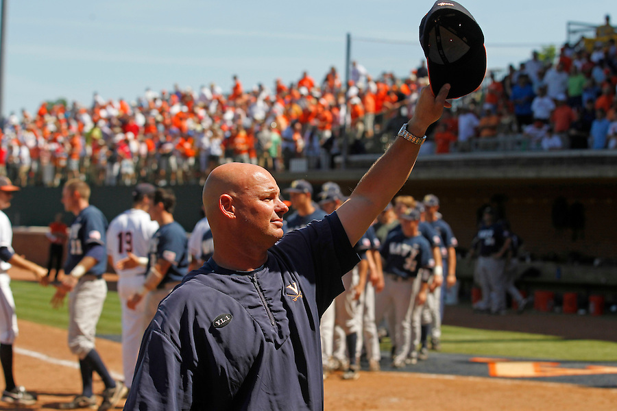 Virginia pitching coach Karl Kuhn takes his hat off to the fans after the Victory over Navy in game one of the 2011 NCAA regionals last weekend. Photo/Andrew Shurtleff