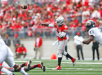 Ohio State Buckeyes quarterback J.T. Barrett (16) makes a throw against Kent State in first half play at Ohio Stadium on September 13, 2014.  (Chris Russell/Dispatch Photo)