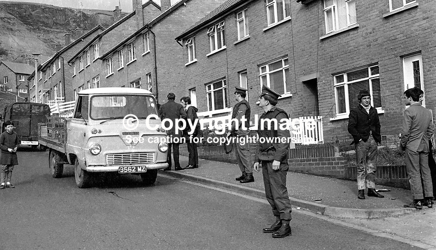 Army military policeman keeps an alert eye whilst plainclothes detectives investigate the attempted murder in Ballymurphy, Belfast, N Ireland, of milkman Tom Cahill. Cahill was a victim of a power struggle beween the Provision and Official IRAs. Tom Cahill is a brother of prominent Provisional IRA man Joe Cahill. See bloodstain on road at front of small lorry being driven by Cahill. 197103090167e.<br /> <br /> Copyright Image from Victor Patterson, 54 Dorchester Park, Belfast, UK, BT9 6RJ<br /> <br /> t1: +44 28 9066 1296<br /> t2: +44 28 9002 2446<br /> m: +44 7802 353836<br /> <br /> e1: victorpatterson@me.com<br /> e2: victorpatterson@gmail.com<br /> <br /> www.victorpatterson.com<br /> <br /> IMPORTANT: Please see my Terms and Conditions of Use at www.victorpatterson.com
