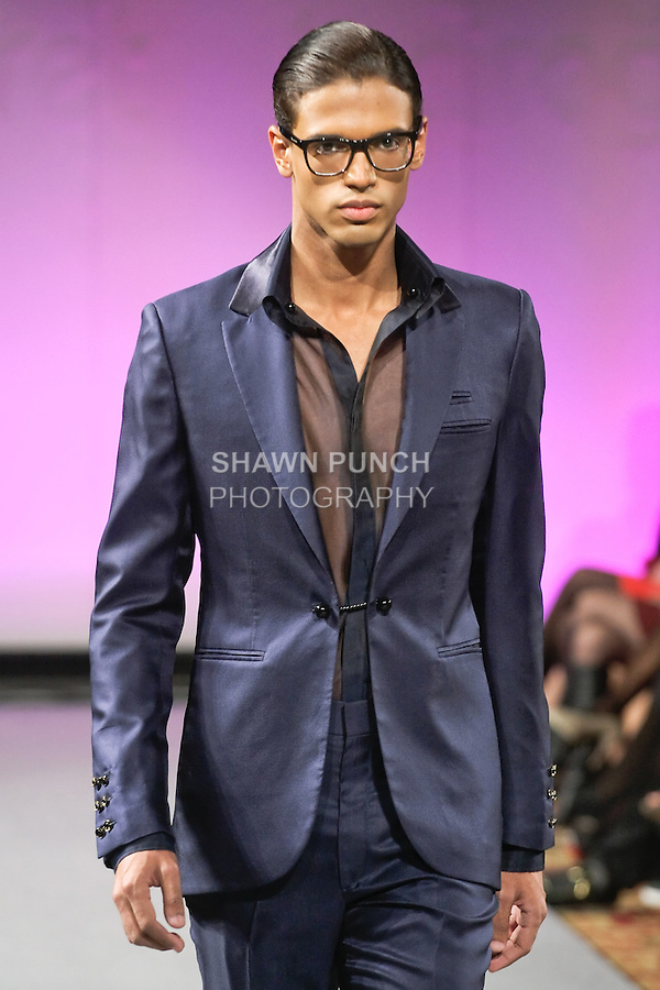 """Model walks runway in an outfit from the ALICAT Avril Lemieux 2012 """"Stolen Loot"""" collection, during Couture Fashion Week New York Fall 2012."""