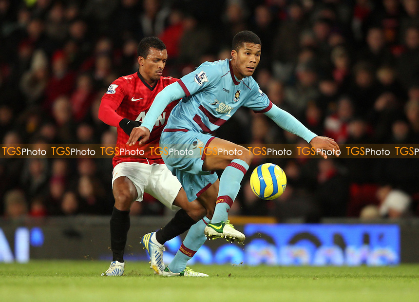 Jordan Spence of West Ham and Nani of Man Utd - Manchester United vs West Ham United, FA Cup 3rd Round Replay at Old Trafford, Manchester - 16/01/13 - MANDATORY CREDIT: Rob Newell/TGSPHOTO - Self billing applies where appropriate - 0845 094 6026 - contact@tgsphoto.co.uk - NO UNPAID USE.