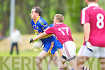 Spa Andrew Garnett is stopped by Dromid's Donnacha O Suilleabhain during their Intermediate semi final in Killorglin on Saturday