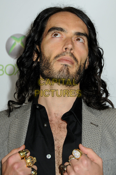 RUSSELL BRAND .EMI Post Grammy Party 2010 held at the W Hollywood Hotel, Hollywood, California, USA, 31st January 2010..portrait headshot beard hairy chest grey gray black hands rings gold silver beard facial hair looking up grammys .CAP/ADM/BP.©Byron Purvis/Admedia/Capital Pictures