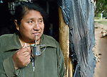 Nelida Alpiri is a Guarani indigenous leader in Bananal, a small village in the Chaco region of Argentina where residents have struggled to defend their land and their rights against giant agro-export plantations and cattle raisers. Here she drinks mate in the doorway of her home.