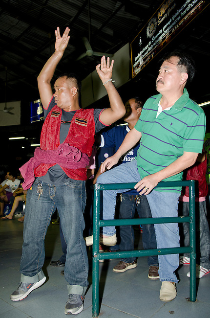 Bangkok, August 30,2011 Lumpini Muay Thai boxing stadium; trainers react to the action in the ring.