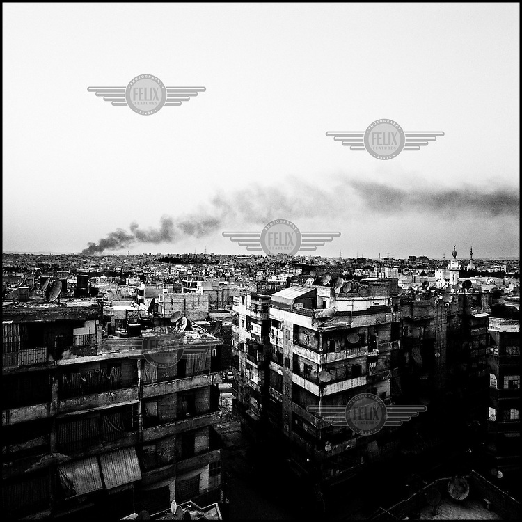 Syria/Aleppo/Aug 29,2012/View of  Aleppo city from the roof of  the Dar al-Shifa hospital during  airstrike bombings.Over 60,000 of Syrians have died since the uprising began in March 2011 and  more than 500,000 of Syrian refugees have fled the country to neighboring Turkey,Lebanon,Jordan and Iraq.Giorgos Moutafis
