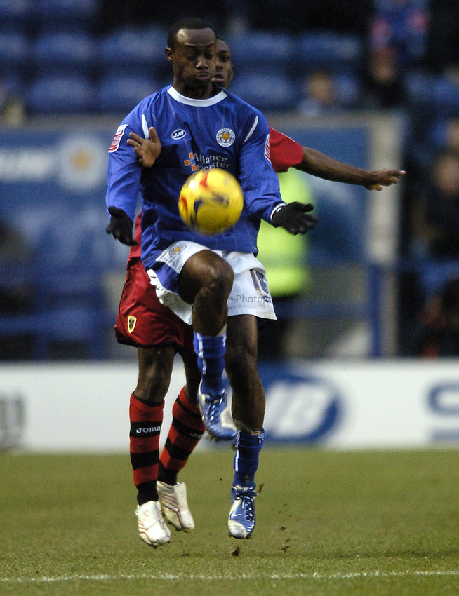 Photo: Jonathan Butler..Leicester City v Cardiff City. Coca Cola Championship. 23/12/2006..Elvis Hammond of Leicester controls the ball under the watchful eye of Kerrea Gilbert of Cardiff.