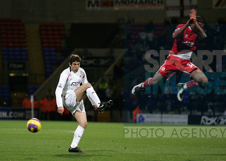 Bolton's Andranik (L) miss times a shot at goal during their Barclays Premiership Football match at the Reebok Stadium, Bolton, 11th November 2007.