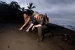 Jaguar (Panthera onca) biologists, Stephanny Arroyo-Arce and Ian Thomson, checking out jaguar tracks on beach, Coastal Jaguar Conservation Project, Tortuguero National Park, Costa Rica