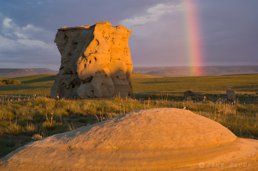 Rainbow and sandstone rock formation at Medicine Rocks State Park, Montana