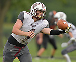Dupo quarterback C.J. Robinson reaches behind himself to snag a bad snap. Wesclin defeated Dupo 34-30 on Saturday August 31, 2019 in a game that was stopped Friday night at halftime due to storms. <br /> Tim Vizer/Special to STLhighschoolsports.com