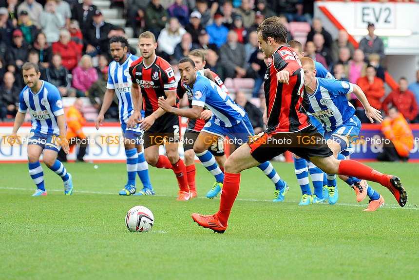 Brett Pitman of AFC Bournemouth steps up to take a penalty which Scott Carson of Wigan Athletic saved - AFC Bournemouth vs Wigan Athletic - Sky Bet Championship Football at Goldsands Stadium, Bournemouth, Dorset - 17/08/13 - MANDATORY CREDIT: Denis Murphy/TGSPHOTO - Self billing applies where appropriate - 0845 094 6026 - contact@tgsphoto.co.uk - NO UNPAID USE
