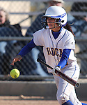 Western Nevada's Madison Gonzalez lays down a one-handed bunt during a college softball game against the College of Southern Idaho in Carson City, Nev., on Friday, March 22, 2013..Photo by Cathleen Allison/Nevada Photo Source