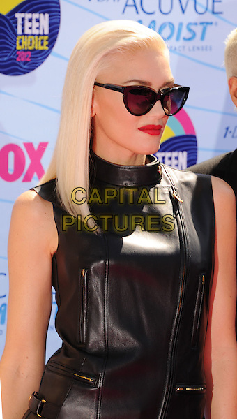 Gwen Stefani of No Doubt.FOX's 2012 Teen Choice Awards held at The Gibson Ampitheatre in Universal City, California, USA..July 22nd, 2012.half length black leather sunglasses shades red lipstick sleeveless top.CAP/ROT/TM.©Tony Michaels/Roth Stock/Capital Pictures