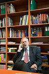 Dr Jean-Pierre Droz, Oncology unit, Centre Leon Berard, Lyon, France. The doctor in his office surrounded by books. On  the telephone.