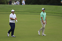 Patrick Reed (USA) an Dean Burmester (RSA) on the 18th fairway during the 3rd round of the DP World Tour Championship, Jumeirah Golf Estates, Dubai, United Arab Emirates. 17/11/2018<br /> Picture: Golffile | Fran Caffrey<br /> <br /> <br /> All photo usage must carry mandatory copyright credit (© Golffile | Fran Caffrey)