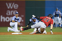 Will Craig (25) of the Indianapolis Indians is tagged out by Charlotte Knights shortstop Ryan Goins (1) as he tried to stretch a single into a double at BB&T BallPark on April 27, 2019 in Charlotte, North Carolina. The Indians defeated the Knights 8-4. (Brian Westerholt/Four Seam Images)