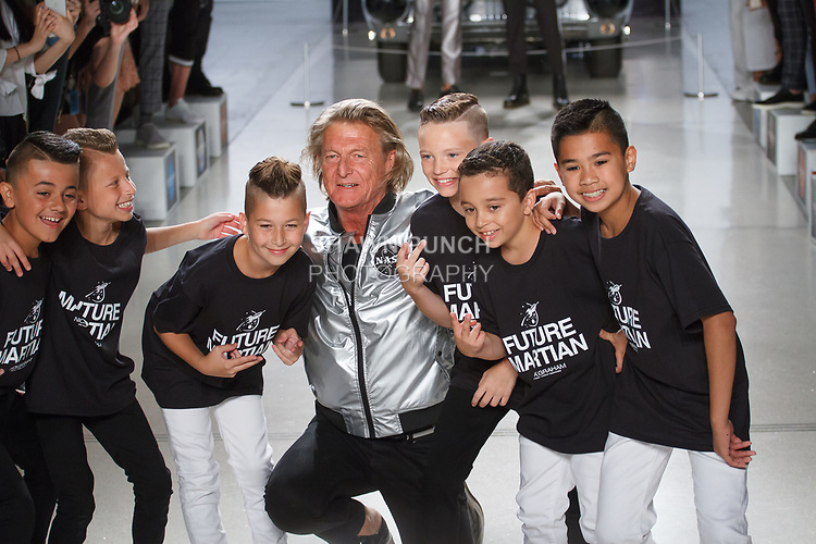 "Fashion designer Nick Graham poses with Icon Dance Complex group at the close of his Nick Graham Spring Summer 2019 ""1969"" collection in at Cadillac House in New York City on July 10, 2018; during New York Fashion Week: Men's Spring Summer 2019."