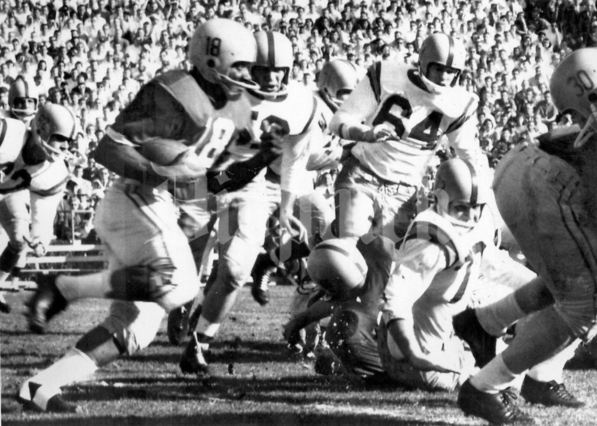 Ohio State running back Don Clark gains 27 yards in the first quarter against Oregon in the 1958 Rose Bowl. The Buckeyes won 10-7 to cap off a national championship season for 1957.  United Press Telephoto ACME Newspictures