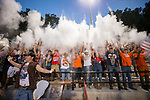 The Northwest Cabarrus Trojans student section tosses baby powder in the air following the opening kick-off in the varsity football game against the East Rowan Mustangs at Trojan Stadium September 22, 2017, in Concord, North Carolina.  The Trojans defeated the Mustangs 48-6.  (Brian Westerholt/Sports On Film)