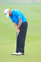 Thomas Bjorn (DEN) putts on the 1st green during Thursday's Round 1 of the 2014 BMW Masters held at Lake Malaren, Shanghai, China 30th October 2014.<br /> Picture: Eoin Clarke www.golffile.ie