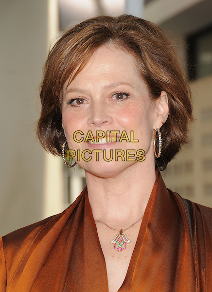 SIGOURNEY WEAVER .attends The Universal Pictures World Premiere of The Tale of Despereaux held at The Arclight Theatre in Hollywood, California, USA,.December 7th 2008                                                                     .portrait headshot orange blouse brown gold hoop earrings  necklace .CAP/DVS.©Debbie VanStory/Capital Pictures