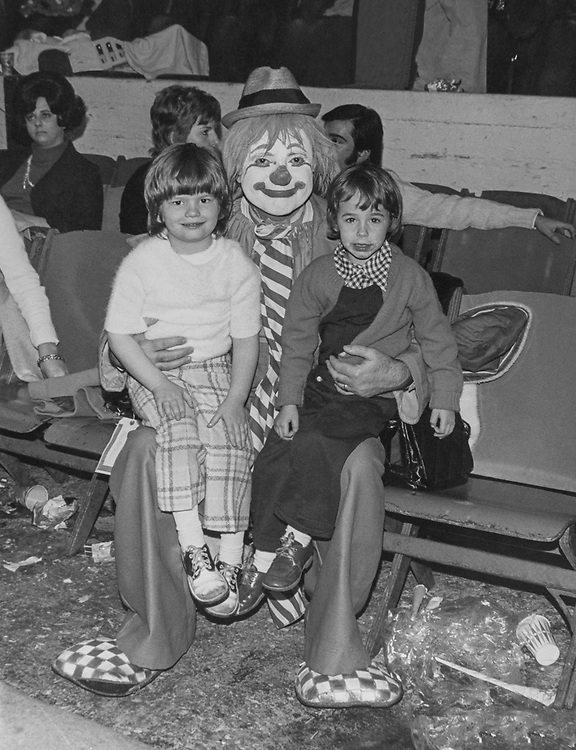 Clown along with two children. (Photo by CQ Roll Call via Getty Images)